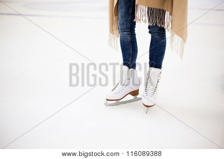 Girl standing on opened skating rink