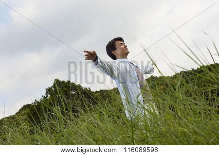 Man Outstretching Arms In Nature