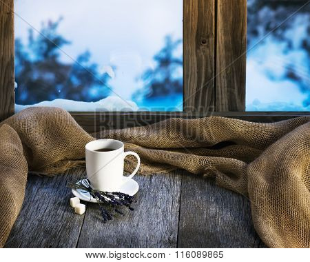 White Cup Of Coffee Or Tea, Lavender Flowers And Natural Gunny Cloth.