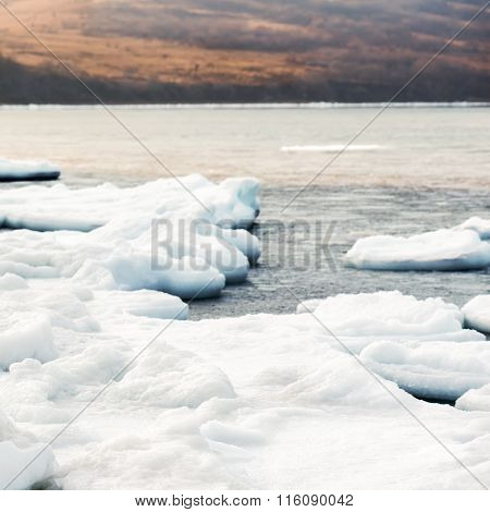 Natural Sea Ice Blocks Breaking Up Against Shore. .