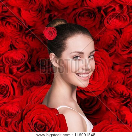 Woman face on the red roses background