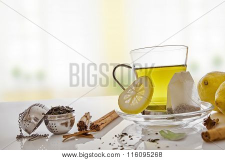 Green Tea With Cinnamon Lemon And Infusers Front View