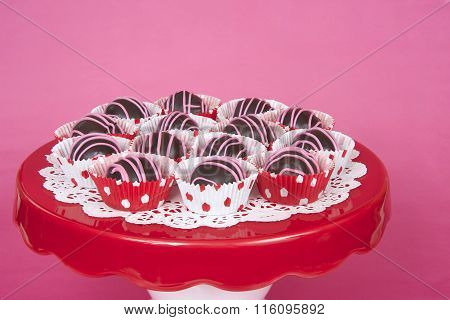 Chocolate Cake Balls In Red And White Polka Dot Mini Cup Cake Liners Pink Background