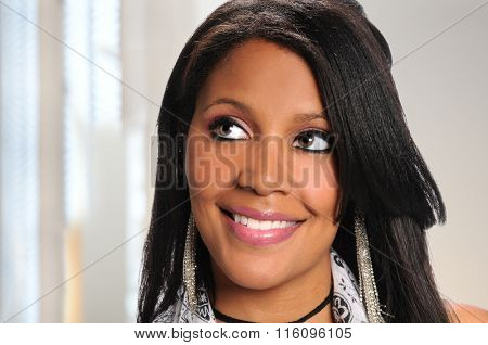 African American businesswoman looking up inside office environment