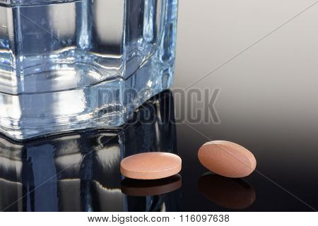 Statin Tablets With Glass Of Water