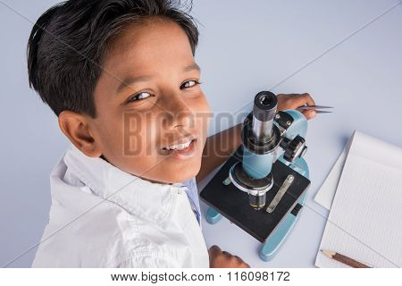 indian boy and microscope, asian boy with microscope, Cute little kid holding microscope, 10 year ol