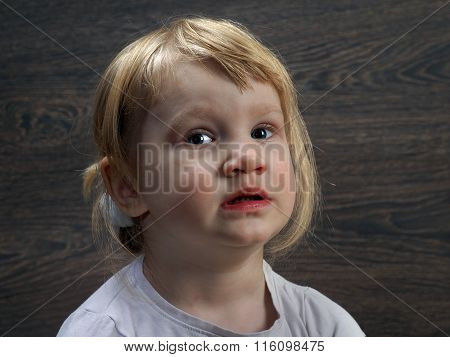 Portrait of a child. Face of a little girl coarse