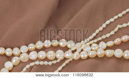 Pearl Beads On Brown Cloth