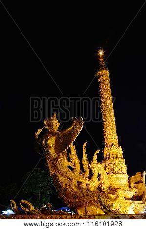 Garuda sculpture on big candle used in raining season