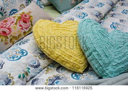 Two Pillows In The Form Of Hearts Lie On The Bed