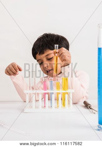 4 year old indian boy doing science experiment, science Education. asian kid and science experiments