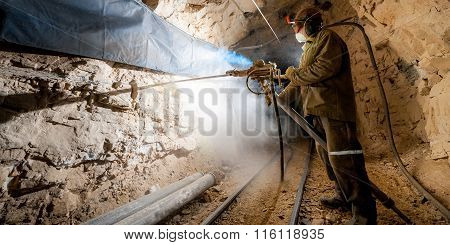 Miner inside a gold mine.