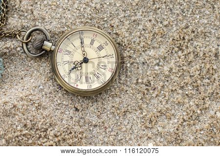 Old Pocket Watch In The Sand