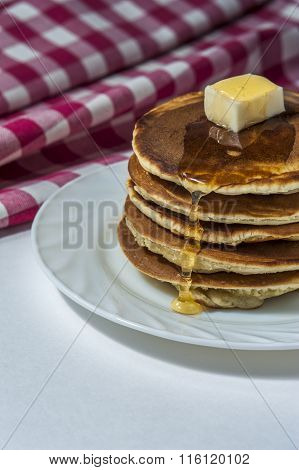 Stack Of Homemade Pancakes With Butter And Honey