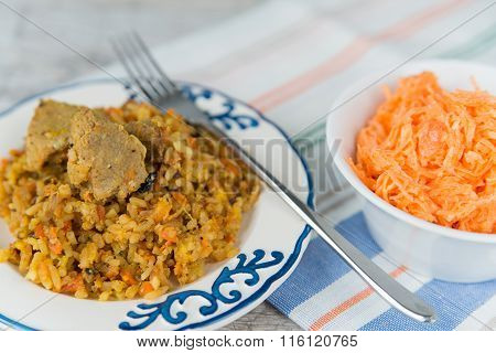 Plate Of Rice And Meat Dish Pilau And Carrot Salad