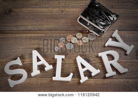 Salary Sign And Emty Black Purse With British Coins