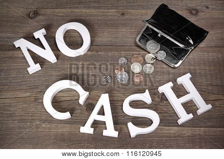 No Cash Sign And Emty Black Purse With British Coins