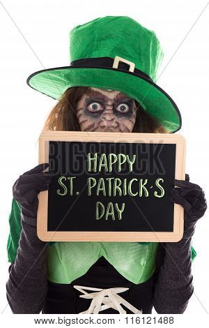 Funny Leprechaun Girl Holding A Slate With Text Happy St. Patrick´s Day