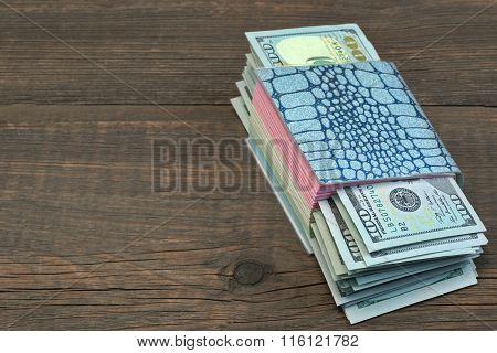 Notebook With Tear-off Sticker Pages And Dollar Cash On Wood