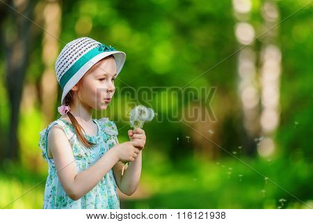 Little Girl Blowing Dandelion