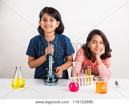 curious indian girls with microscope