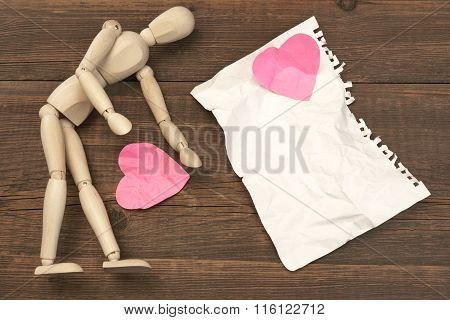 Wood Humane Figurine, Torn Paper Page And Broken Hearts