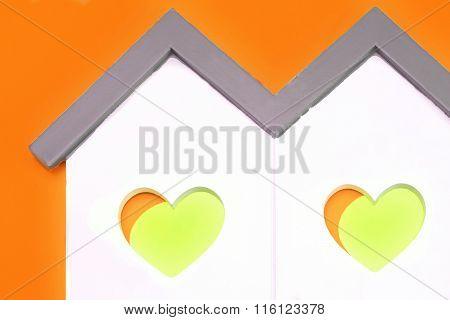 White Home Shape With  Orange Yellow Heart Shape Window