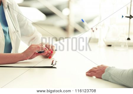 Male patient visiting doctor on light background