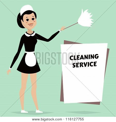 Maid in classic maid dress with cleaning duster. Cleaning service advertisement with space for text.