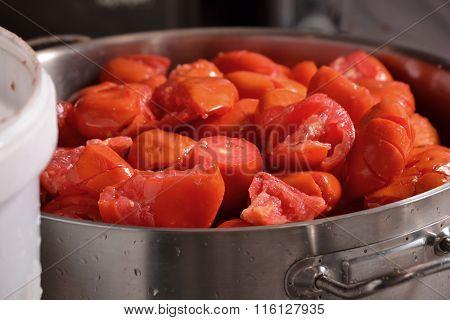 Peeled tomatoes on pan.