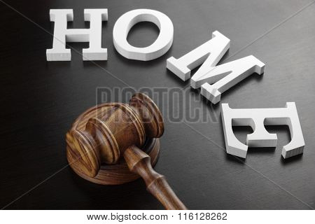 Judges Gavel And White Sign Home On Black Wood  Background.
