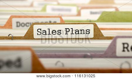 Sales Plans Concept on File Label.
