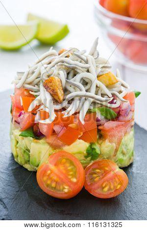 Vegetables and baby eels or elvers tartar