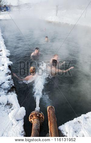 People Relaxing In Geothermal Spa In Hot Spring Pool