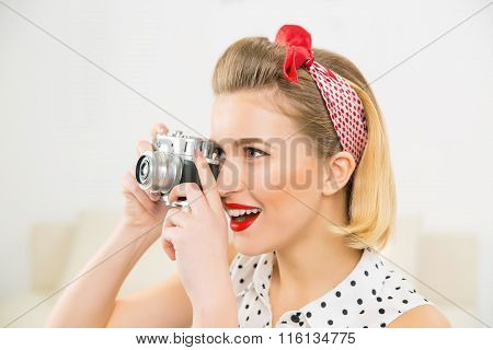 Young attractive woman is taking a photo picture.