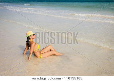 Woman On Beach Vacation Sunbathing At Seashore