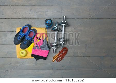 Fitness Equipment With Copy Space On Gray Wooden Plank Floor