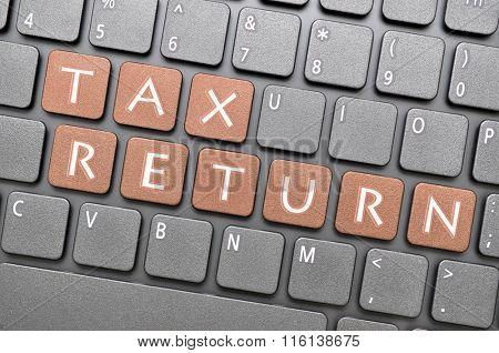 Brown tax return key on keyboard