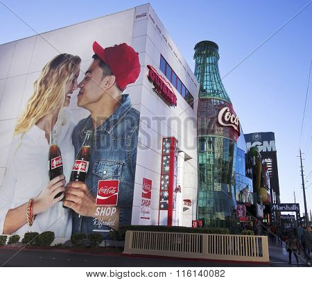 A Giant Coke Sign And Bottle On The Strip