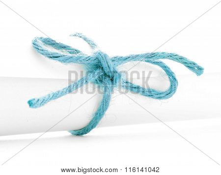 Handmade Blue Rope Node Tied On White Letter Roll Isolated