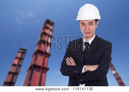 Engineer In Helmet With Arms Crossed, Construction Pillar Background