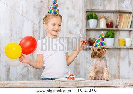Little girl celebrating her pets birthday.