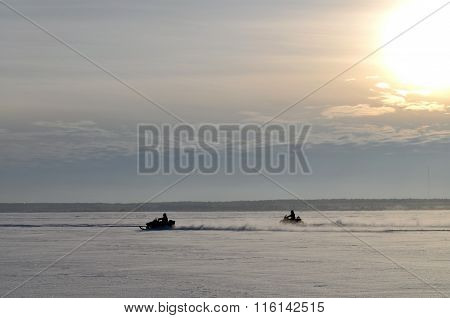Men Riding On A Snowmobile