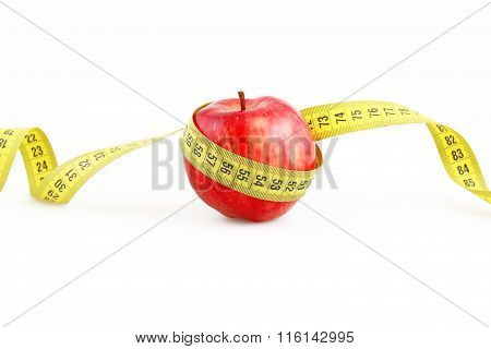 Red Apple And Measuring Metre On A White Background