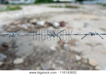The barbed wire fence.