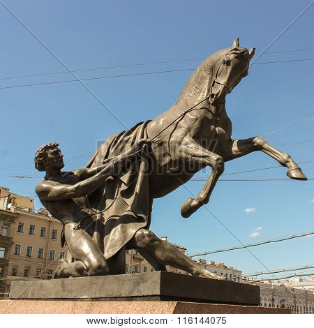 Sculpture Of Horse And Human.