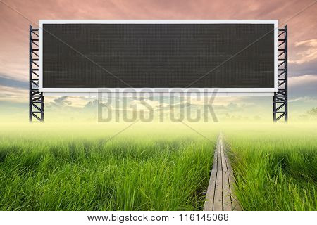 Empty Large Sign With Wood Bridge Between Rice Field