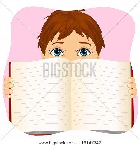 little boy holding a book wide open