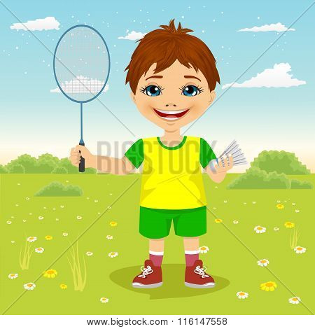 Young boy with badminton racket and shuttlecocks