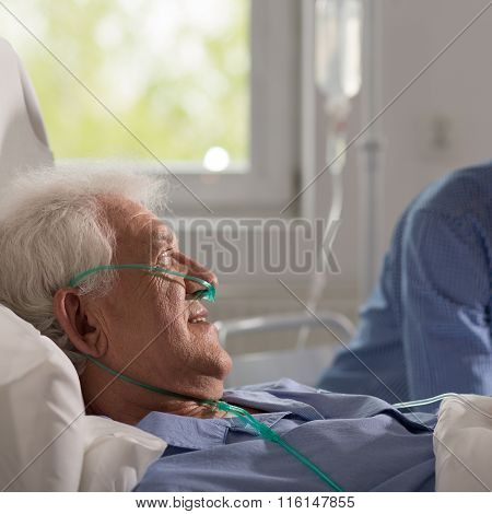 Grandson Visiting Ill Grandfather